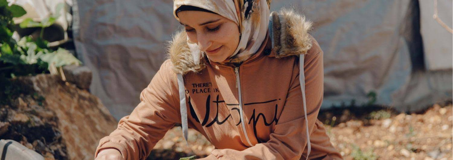 Douaa El Mahmoud, Syrian Refugee and Law student in her garden next to her tent in an informal tented settlement located in Baaloul, Bekaa.